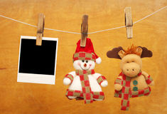 Photos hanging on clothespins Royalty Free Stock Image