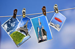 Photos hanging on a rope. Vacation photos hanging on a clothesline Royalty Free Stock Image