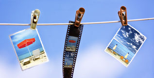 Photos hanging on a rope. Vacation photos and filmstrip hanging on a rope Royalty Free Stock Photo