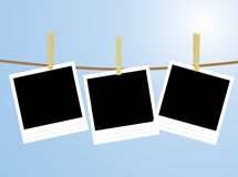Photos hanging on rope Royalty Free Stock Photos