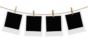 Photos hanging on a rope. Attached clip Stock Photos