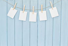 Photos hanging on rope with clothespins Stock Photo