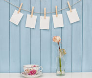 Photos hanging on rope with clothespins Royalty Free Stock Images