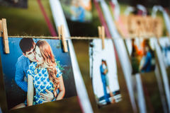 Photos hanging on a rope. Photos of lovers hanging on a rope outdoors Royalty Free Stock Photo