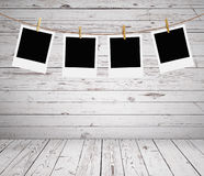 Photos. Hanging on a rope in wooden room Stock Photos