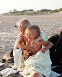 Photos happy kids in the summer on the sand. Brother and sister Royalty Free Stock Photos