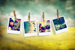 Photos of holiday hanging on clothesline with grunge background Royalty Free Stock Photos