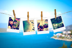 Photos of holiday hanging on clothesline with sea Royalty Free Stock Photo