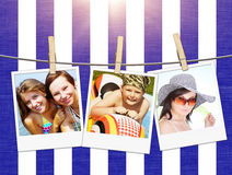 Photos of holiday people hanging on clothesline on beach Royalty Free Stock Images