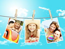 Photos of holiday people hanging on clothesline by Royalty Free Stock Photography