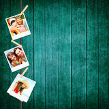 Photos of holiday people hanging on clothesline Stock Photo