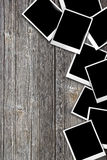 Photos laid on wooden. Table background Royalty Free Stock Photography