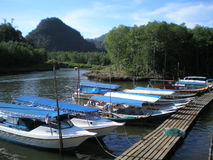Photos with landscape background tropical forests of the archipelago of Langkawi island in Malaysia. Tourist boat water taxi transporting vacationers and Royalty Free Stock Images