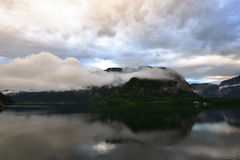 Photos of mountain, lake with morning fog over the lake in Hallstatt of Austria Royalty Free Stock Photography