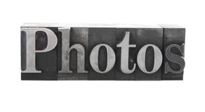'Photos' in old metal type Royalty Free Stock Image