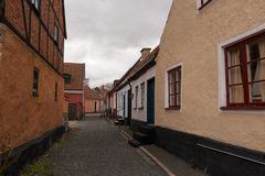 Simrishamn tour of the old town. Photos of the old town, narrow allies, The Church, Brickstone houses. Colours and paved streets Royalty Free Stock Images