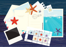 Photos, postcards, mails and starfish stickers. An illustration of some photos, postcards, mails and starfish stickers on wooden wall Royalty Free Stock Photography