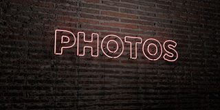 PHOTOS -Realistic Neon Sign on Brick Wall background - 3D rendered royalty free stock image. Can be used for online banner ads and direct mailers vector illustration
