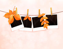 Photos on rope with clothespins and autumn leaves vector Royalty Free Stock Images