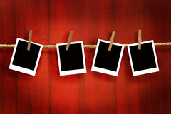 Photos  on rustic red wood Stock Photography
