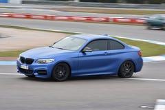 Car motosport photos. This photos show cars racing on a local street racing circuit royalty free stock images