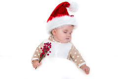 Photos of smiling young baby in a Santa Claus hat stock photography