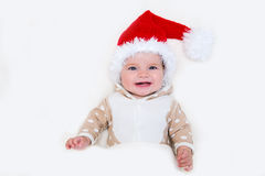 Photos of smiling young baby in a Santa Claus hat Stock Photo