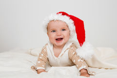 Photos of smiling young baby in a Santa Claus hat Royalty Free Stock Photography