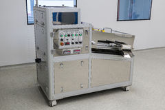 Photos sterile production area with the machine for the production of tablets and sorting. Photos sterile production area with stainless steel machine for the royalty free stock photos