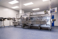 Photos sterile production area with the machine for the production of tablets and sorting. Photos sterile production area with stainless steel machine for the royalty free stock images