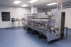 Photos sterile production area with the machine for the production of tablets and sorting. Photos sterile production area with stainless steel machine for the stock images