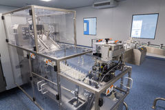 Photos sterile production area with the machine for the production of tablets and sorting. Photos sterile production area with stainless steel machine for the stock photography