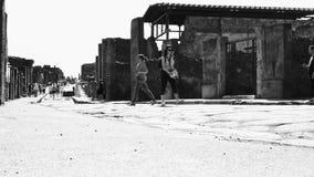 Photos in street of Pompeii stock footage