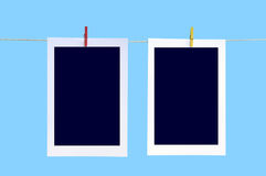 Photos on Wash Line. Illustration of two photos hanging on a wash line over blue background stock illustration