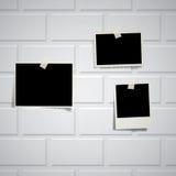 Photos on white brickwall. Vector vintage blank photos on white brickwall royalty free illustration