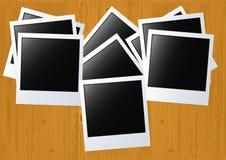 Photos on a wooden board. Stock Photos