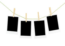 Photos and wooden clothespins isolated Royalty Free Stock Images