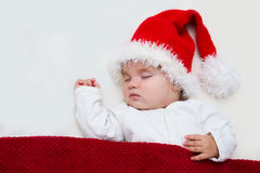 Photos of young baby in a Santa Claus hat Royalty Free Stock Photography