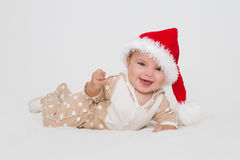 Photos of young baby in a Santa Claus hat Royalty Free Stock Image