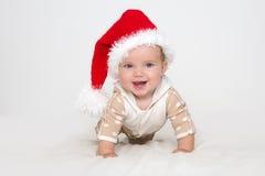 Photos of young baby in a Santa Claus hat Stock Photos