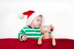 Photos of young baby in a Santa Claus hat Stock Images