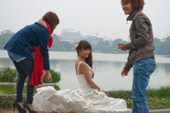 Photosession of the bride in a white dress on the street. Hanoi. Vietnam Stock Images