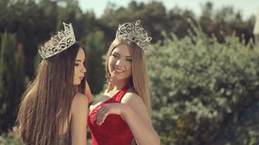 Photosession of two charming girls for beauty. Photosession of two charming girls for the beauty contest stock video