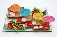 Verbeelding met decoratieve paraplu's en groenten. Stock Afbeelding