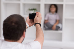 Photoshooting with kid model. At studio as new modern home Stock Images