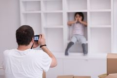 Photoshooting with kid model. At studio as new modern home Stock Image