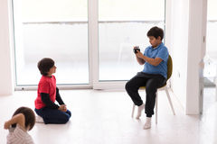 Photoshooting with kids models. At studio as new modern home Stock Image