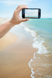 Photoshooting on smartphone at sea Stock Photo