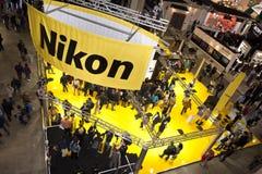Photoshow: De tribune van Nikon stock afbeelding