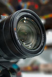 Photoshow 2016 - Paris - France. Close-up photo lens on bokeh Stock Image